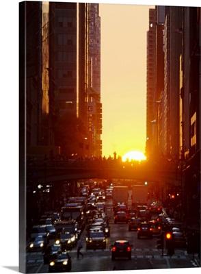 USA, New York, New York City, Sunset illuminating busy street