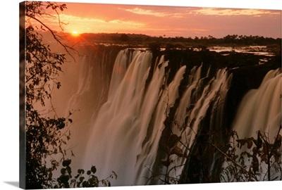 Victoria Falls with sun on horizon, Victoria Falls, Zimbabwe