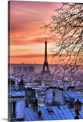 View of Eiffel Tower and Paris roofs from Montmartre at sunset, Paris, France.