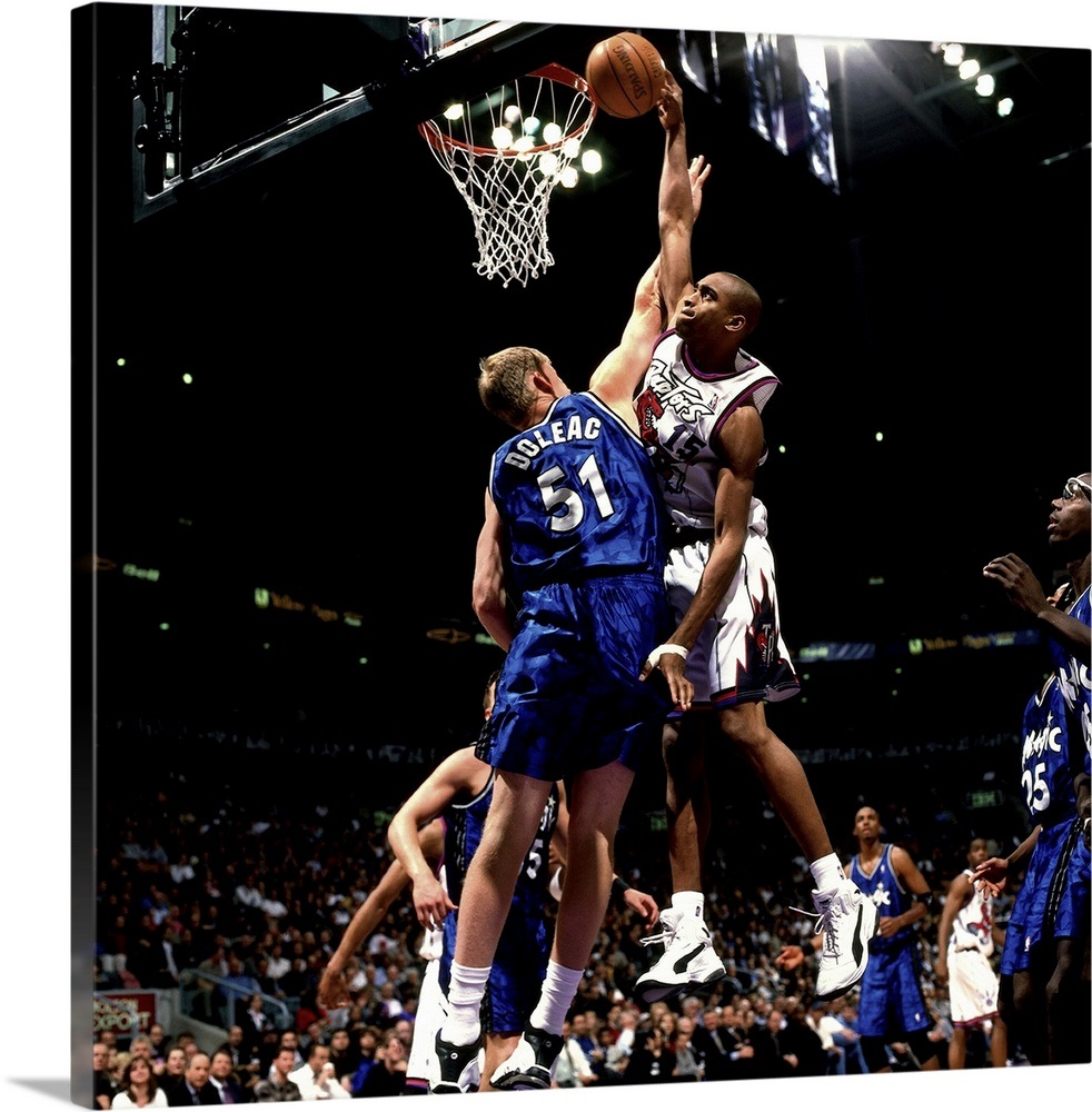6995b49fa Vince Carter of the Toronto Raptors drives to the basket for a slam dunk  Wall Art