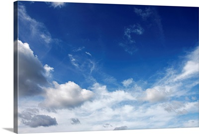 White fluffy clouds on blue sky.