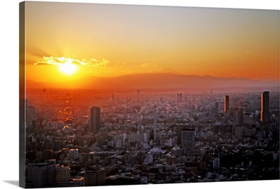 Winter sunset over Tokyo with Mount Fuji in distance, Japan