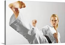 Woman performing martial arts kick