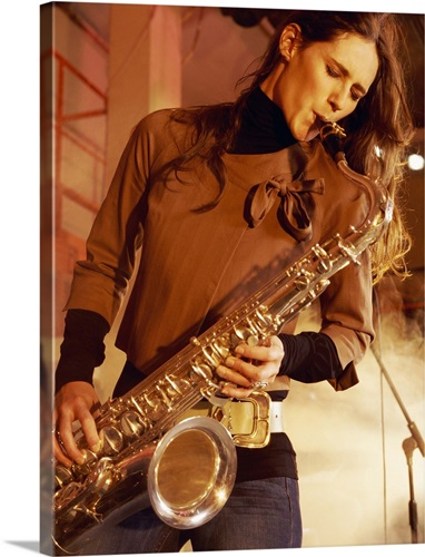 Woman Stands on a Smoky Stage Playing a Saxophone With Passion Wall ...