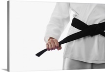 Woman tying karate belt