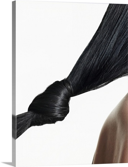 Woman with hair tied in knot, close-up of hair