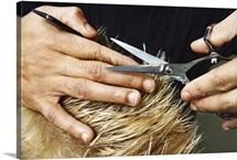 Woman's hands cutting hair