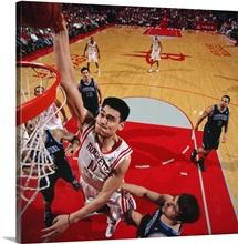 Yao Ming 11 of the Houston Rockets dunks against the Utah Jazz