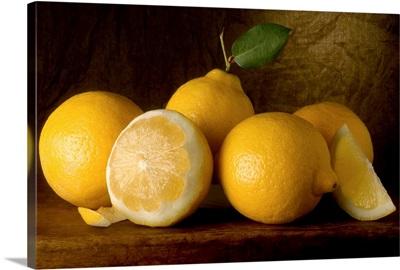 Yellow Lemons on a Board