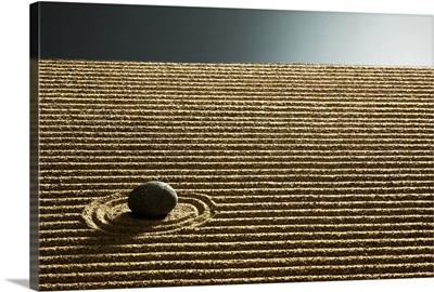 Zen stone on sand