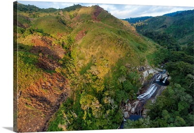 Clear-cuts and remnants of rainforest flank the Vunduzi waterfall