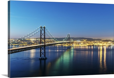 25th of April Bridge over the Tagus river and Lisbon at twilight. Portugal