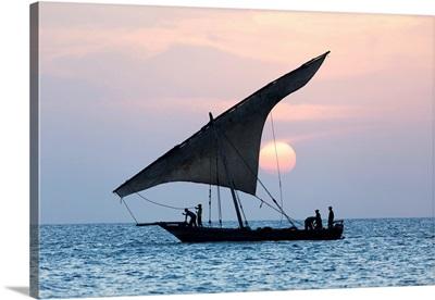A Dhow Sails In Front Of The Setting Sun, Stone Tpwn, Zanzibar, Tanzania