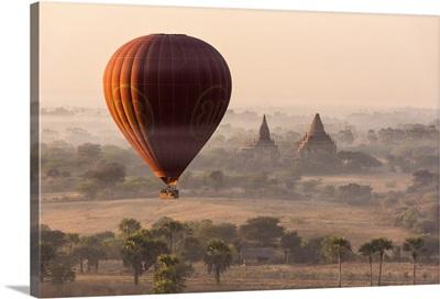 A hot-air balloon flying over pagodas in Bagan, Myanmar.