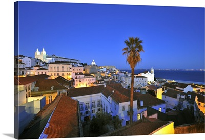 Alfama at dusk, seen from the Portas do Sol belvedere, Lisbon, Portugal