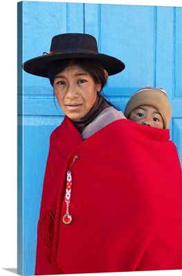 An Aymara Mother With Her Child, In Front Of The Church Of Aparzo, Jujuy, Argentina