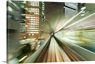 Asia, Japan, Honshu, Tokyo, blurred motion of Tokyo buildings from a moving train