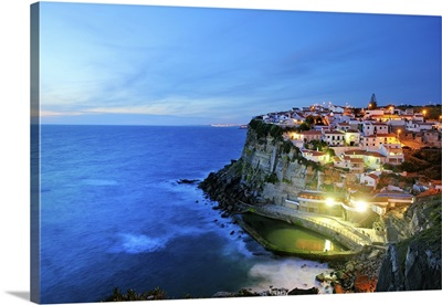 Azenhas do Mar at night, near Sintra, in front of the Atlantic Ocean, Portugal