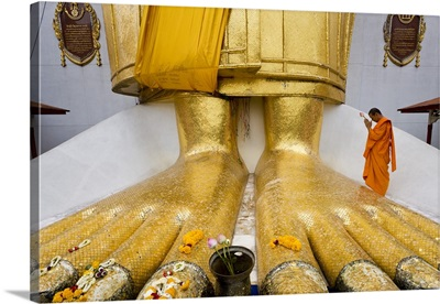 Bangkok, Thailand, Wat Indrawiharn, monk praying at Giant Buddha's feet