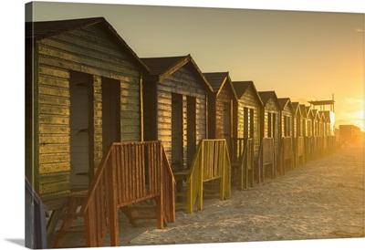Beach huts on Muizenburg beach at dawn, Cape Town, Western Cape, South Africa