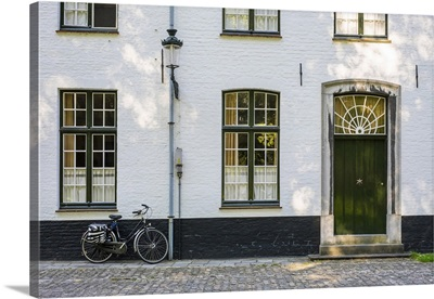 Belgium, Bruges. Bicycle next to a house in the Begijnhof (Beguinage) of Bruges