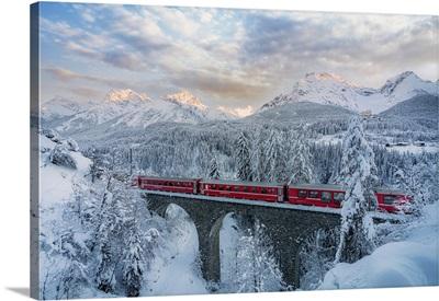 Bernina Express Passes On A Viaduct Near Tarasp, Graubunden, Engadine, Switzerland