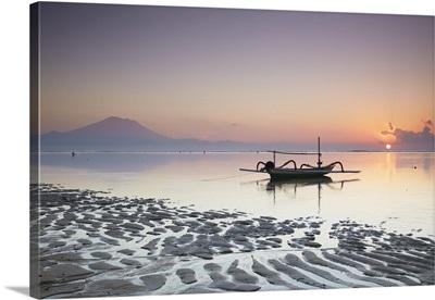 Boat on Sanur beach at dawn, Bali, Indonesia