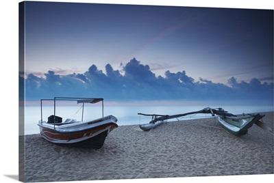 Boats on beach at sunset, Negombo, North Western Province, Sri Lanka