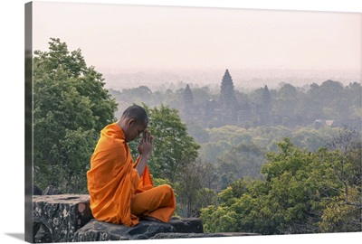 Cambodia, Siem Reap, Angkor Wat complex. Monk meditating