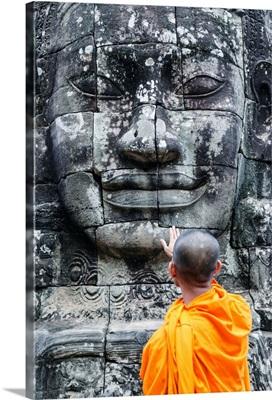 Cambodia, Siem Reap, Angkor Wat complex. Monks inside Bayon temple