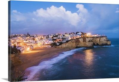 Carvoeiro, Lagoa, Algarve, Portugal, City lights at dusk