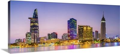 Central Ho Chi Minh City skyline and Saigon River at dusk, Vietnam