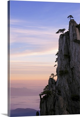 China, Anhui, Huangshan. Sunrise over the famous Huangshan (yellow) mountains