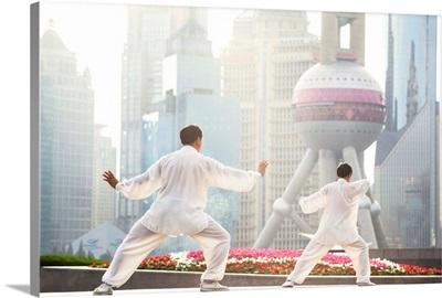 China, Shanghai. Chinese men practising Tai Chi on the Bund