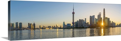 China, Shanghai, Skyline of the Financial District across Huangpu River at sunrise