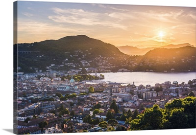 Como, Lombardy, Italy. High angle view over the city and the Como Cathedral at sunset