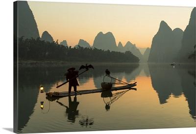 Cormorant fisherman on Li River at dawn, Xingping, Yangshuo, Guangxi, China