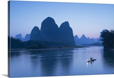 Cormorant fisherman on Li River at dusk, Xingping, Yangshuo, Guangxi, China