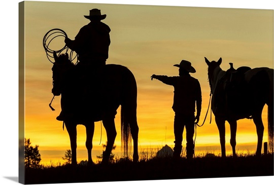 Cowboys and horses in silhouette at dawn on ranch, British Colombia ...