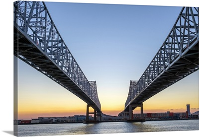 Crescent City Connection, twin span bridges over the Mississippi River at sunset