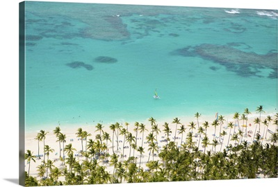 Dominican Republic, Punta Cana, Bavaro beach with a single yacht on the water