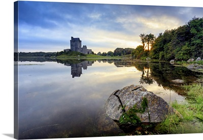 Dublin, Ireland, Dunguaire castle in Kinvara village at sunrise reflecting in the ocean