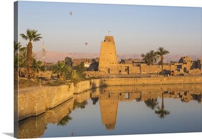 Egypt, Luxor, Karnak Temple, Hot air balloons rise over the Sacred Lake
