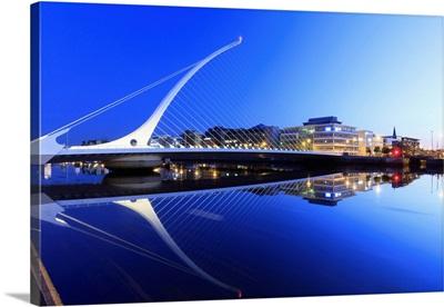 Europe, Dublin, Ireland, Samuel Beckett bridge by night reflecting on the Liffey river