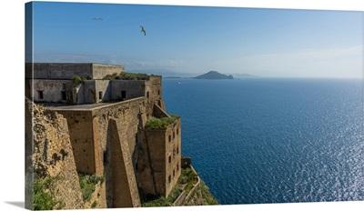 Europe, Italy, Campania. The Palazzo D'avalos Of Procida Seen With Capri Island