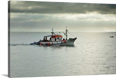 Fishing boat going to the sea, Setubal, Portugal