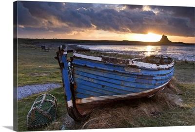 Fishing boat on Holy Island, Lindisfarne Castle beyond, Northumberland, England
