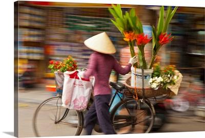 Flower seller in the Old Quarter, Hanoi, Vietnam