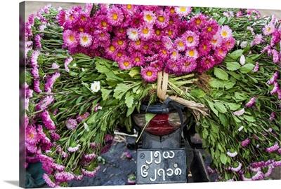 Flowers on back of motorcycle, market, Mandalay, Myanmar (Burma)