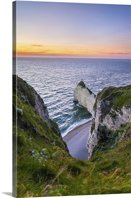 France, Normandy, Seine-Maritime department, Etretat. White chalk cliffs at sunset